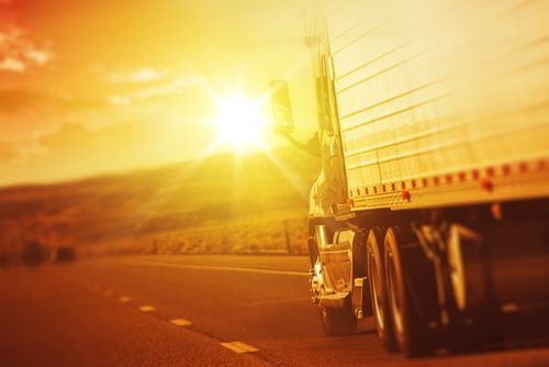 Semi Truck on Highway with Bright Sun